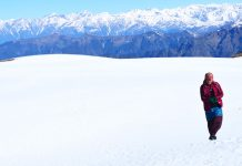 A Himachali woman walks through snow