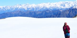 A Himachali woman walks through snow
